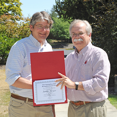 James Meyer receives award from Dean Slinker