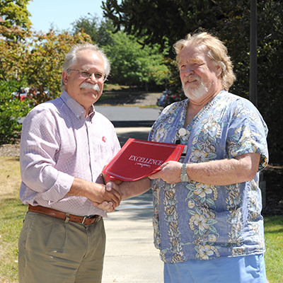 Ronald Munson receives award from Dean Slinker