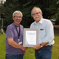 Robert Houston receives his award from Dean Slinker