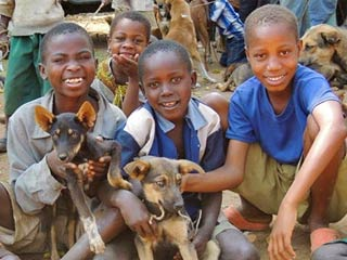 Group of African Children with Dog